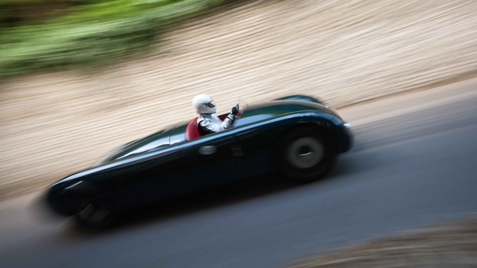 The Aero Alfa in superb motion blur past Goodwood's flint wall: by Scott Dennis