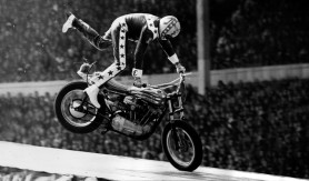 27th May 1975:  American stunt motorcyclist Evel Knievel (Robert Craig) coming in to land after a 90 mph leap over 13 single-deck  buses to a crash landing in which he fractured his hand and damaged his spine.  (Photo by David Ashdown/Keystone/Getty Images)