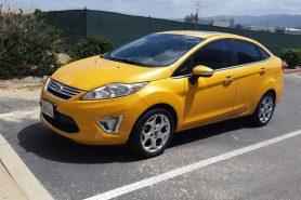 2011_ford_fiesta_sel_sedan-sunshine-frontview